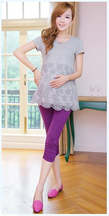เลกกิ้งคนท้องขาสี่ส่วน สีม่วงสด ขยายได้ตามรูปท้อง มีจั้มด้านข้างเนื้อผ้านุ่ม ใส่สบาย