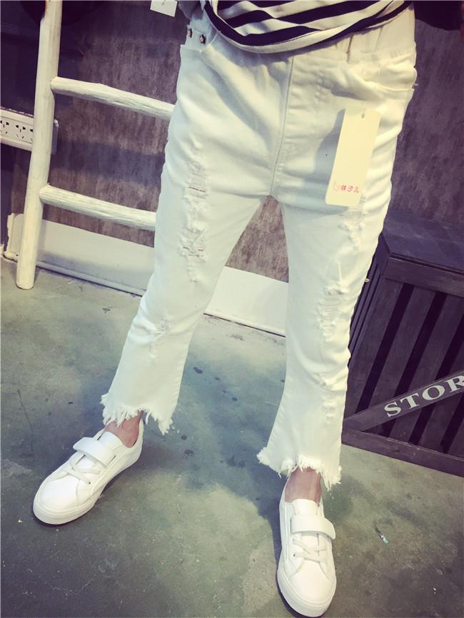 กางเกงขายาวสีขาวขาม้าขาดๆ กางเกงขายาวแฟชั่นเด็ก